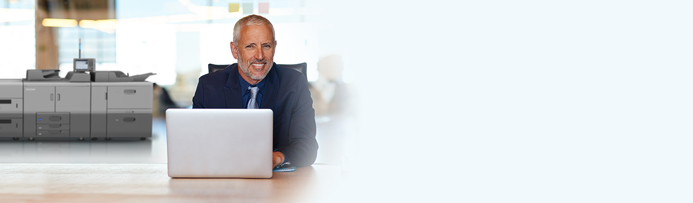 man on laptop sitting at desk
