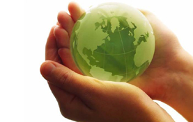 Hands holding a sphere representing earth and the environment.