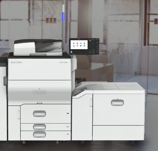 Photo of a printer in front of an office background.