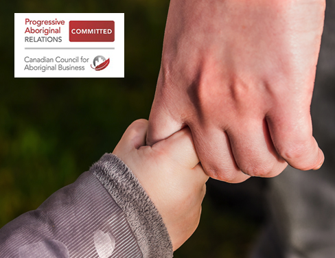 Close up image of small child holding an elderly persons hand.
