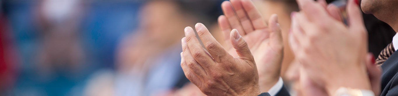 Photo of hands clapping.