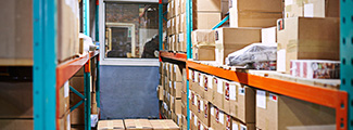 Warehouse shelves with cardboard boxes.