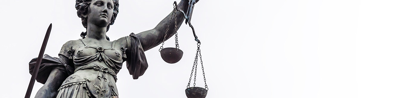 Photo of Lady Justice holding the Scales of Justice.