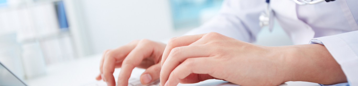 Close up image of nurse typing on a keyboard.
